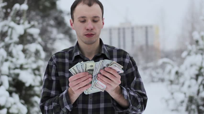 A wealthy guy counts money | Shutterstock HD Video #35038273