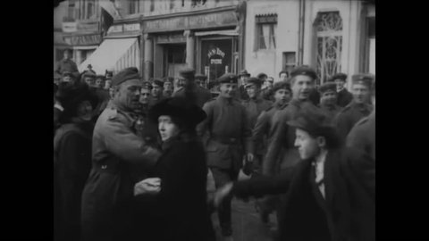 CIRCA - 1918, 1919 - German soldiers withdraw from Luxemburg after the Armistice of WWI, locals watch on the street.