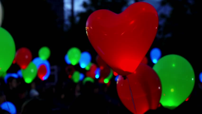 Concept of feast of love. Flying luminous color helium glowing balloons at black background, Suitable for Valentine's day, new year and Christmas, balloon shape of red heart | Shutterstock HD Video #35047735