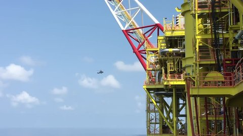 Helicopter landing on jack-up oil rig helideck, Helicopter transfer crews or passenger to work in offshore oil and gas industry, air transportation for support passenger.