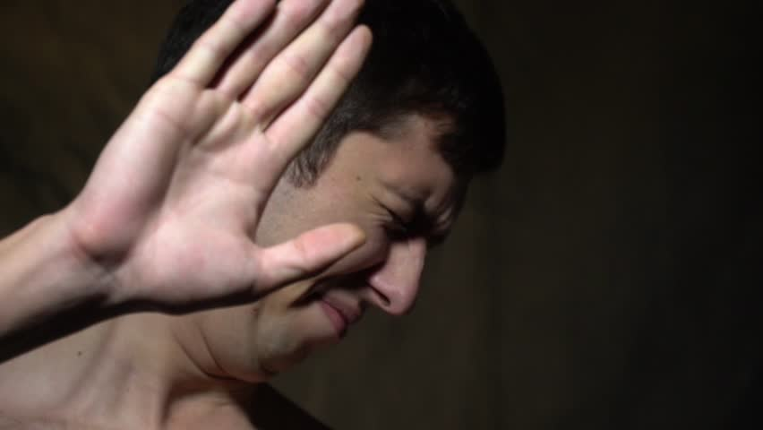 The guy twisted his face and put his hand forward | Shutterstock HD Video #35063245