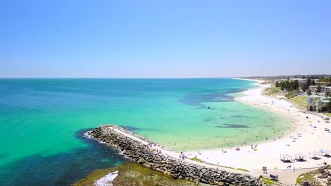Aerial footage of a busy summer day at Cottesloe Beach, Perth, Western Australia.