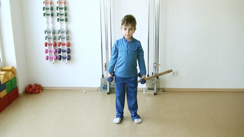 Child does therapeutic exercises in the gym