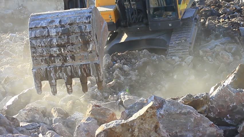 Excavator working in the construction site. Hydraulic excavator works for