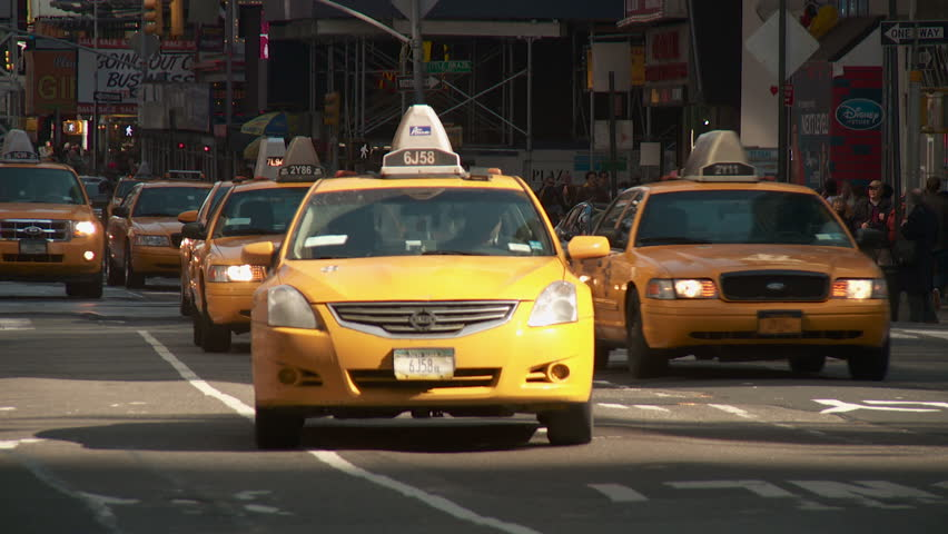 NEW YORK - MARCH 10: Taxis travel south on 7th Avenue through Times Square on March 10, 2013 in New York City.