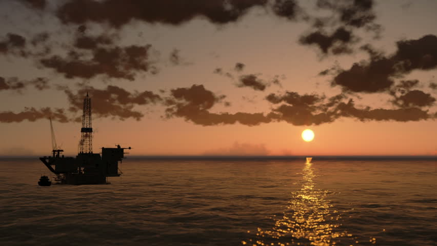 Oil Rig in Ocean, time lapse clouds at sunset, helicopter view