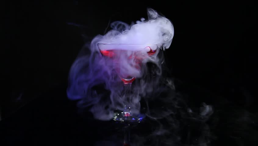 drink in glass with the effect of dry ice