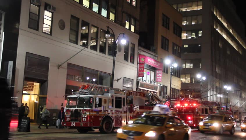 New York, NY - Circa 2011: Fire Truck in Front of Madison Avenue Building at night