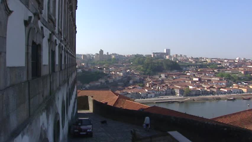 View from Se Cathedral to Vila Nova de Gaia skyline at Douro river - pan. At this side of the Douro the Port wine cellars are located.