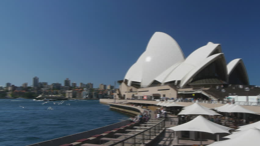SYDNEY, AUSTRALIA - MARCH 13: a panning shot of Sydney Harbour from the opera house to the bridge as seen on March 13, 2013
