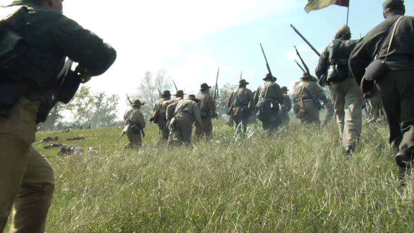 GEORGIA - OCTOBER 2008 - Large-scale, epic Civil War anniversary reenactment -- in the middle of battle.  Confederate Infantry line of battle attacks Union Army under fire, Officers in command. #3566165
