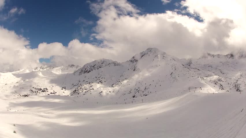 Snowy Mountains and Clouds Timelapse | Shutterstock HD Video #3574577