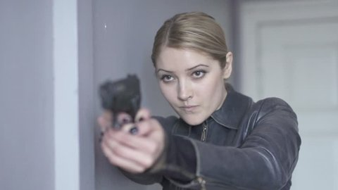 women shooting gun. police officer using gun weapon. women agent. undercover. crime criminal. guns.crime scenery
