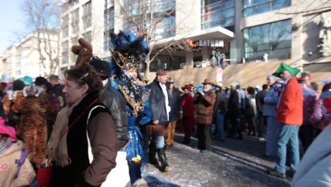 DUSSELDORF, GERMANY – FEBRUARY 10: People present their costumes for the next day celebration of Rosenmontag Karneval or Carnival. February 10, 2013,  Dusseldorf, Germany