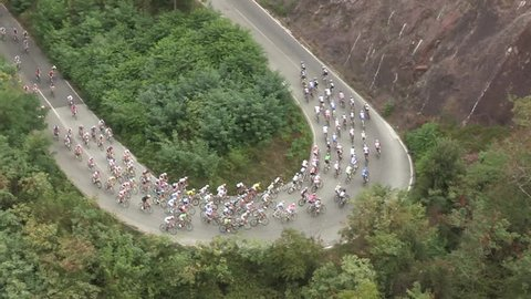 Large group of cyclists at the first stage of a bycicle race