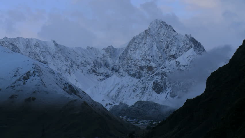 Time Lapse of Caucasus mountains and snowy peaks in Georgia.
