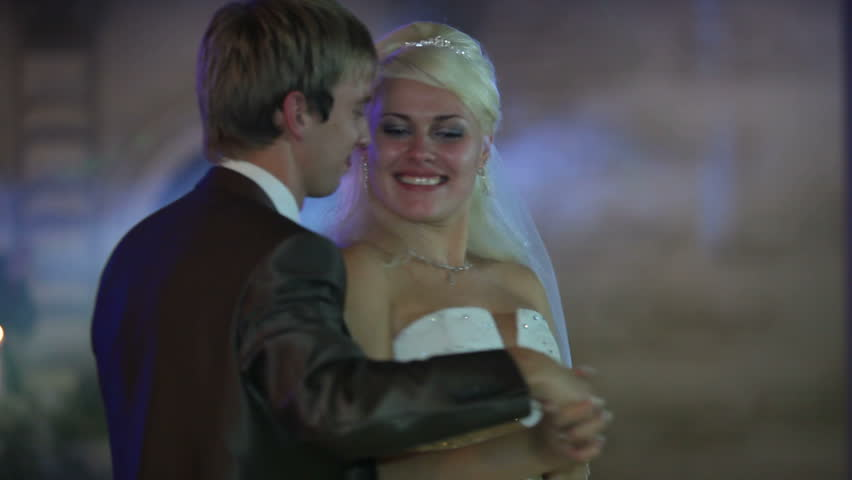 Just married couple is dancing at wedding party.