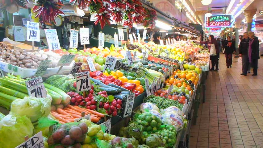 SEATTLE, WASHINGTON - CIRCA 2012: Public market interior at Pike's Place Market fruit and vegetable stand.