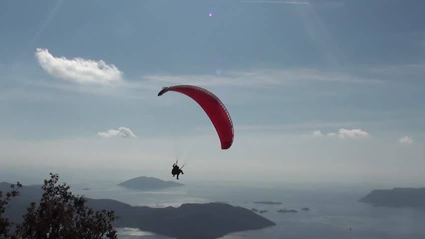Parachute with two people sliding