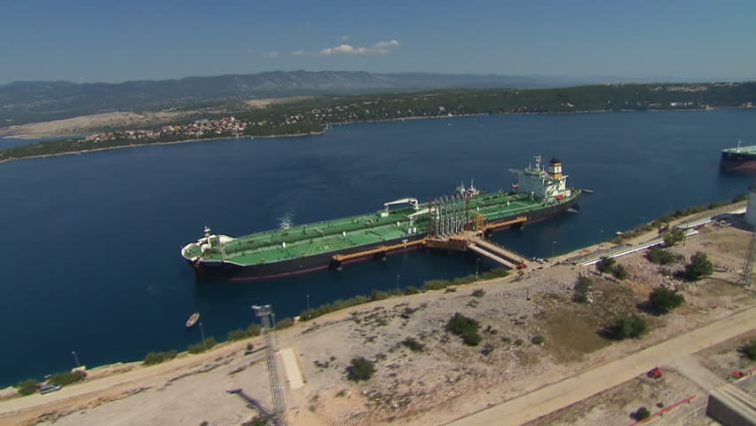 Aerial shot of two tanker boats anchored in LNG terminal