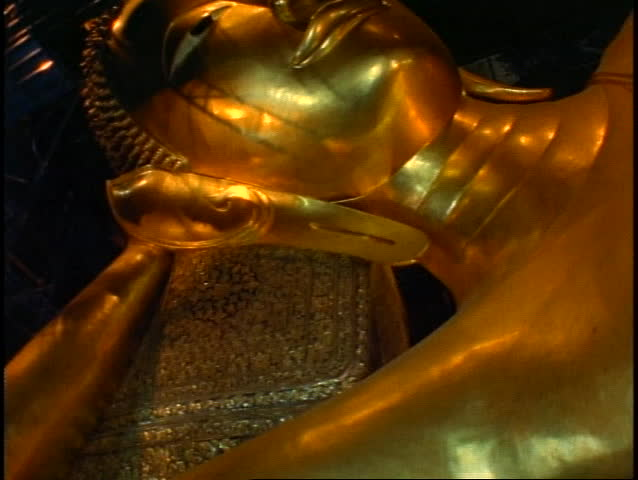 Temple of the Reclining Buddha, The Golden Buddha, close up face of gold, tilt up