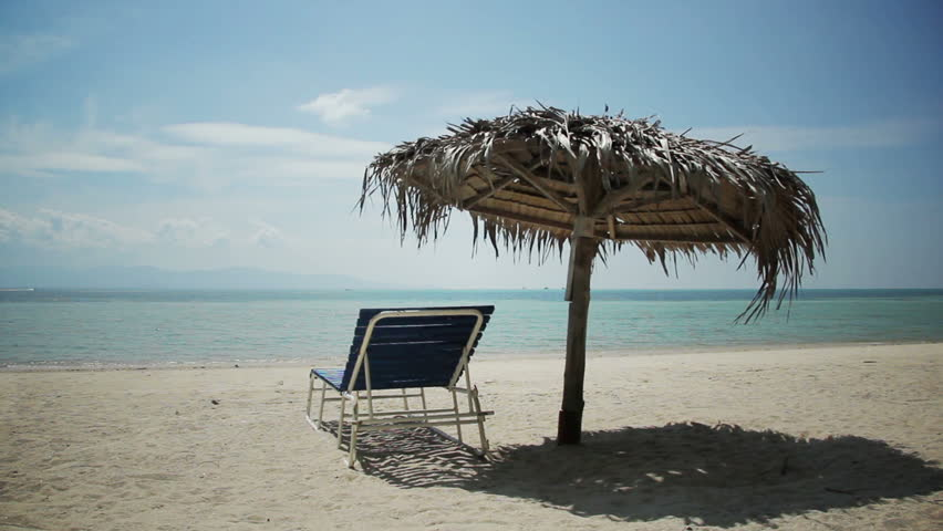 Beach Chair On Sand Vacation Stock Footage Video 100 Royalty Free 3679145 Shutterstock