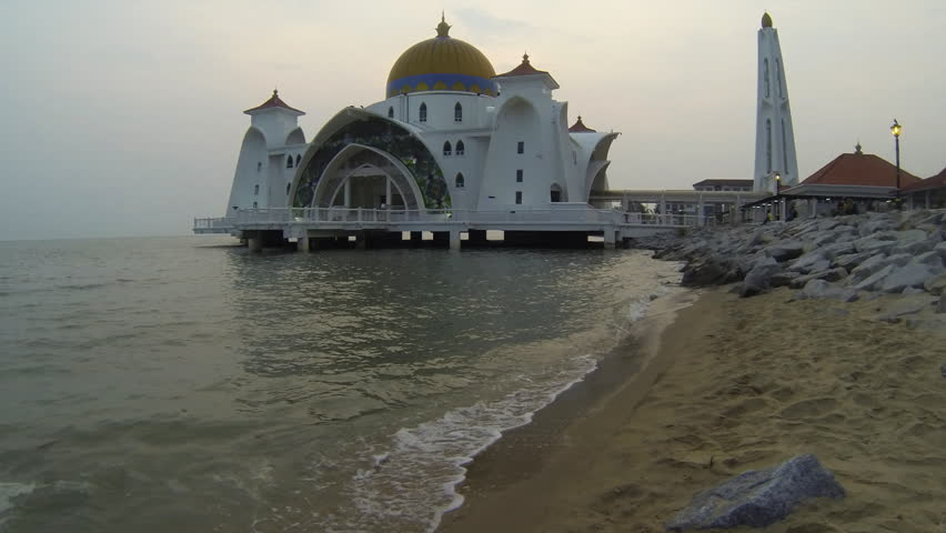 Time lapse at sunset of Selat Mosque in Malacca island Malaysia also known as Malacca Straits mosque