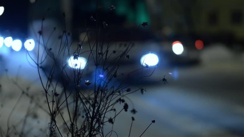 SIBU, ROMANIA - DEC 18, 2012 - Car traffic in city at night defocused