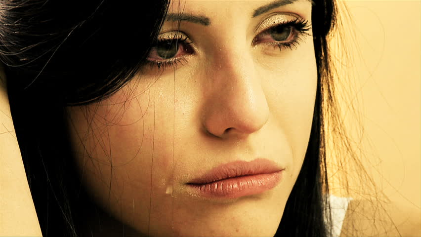 Woman crying one lonely tear sad