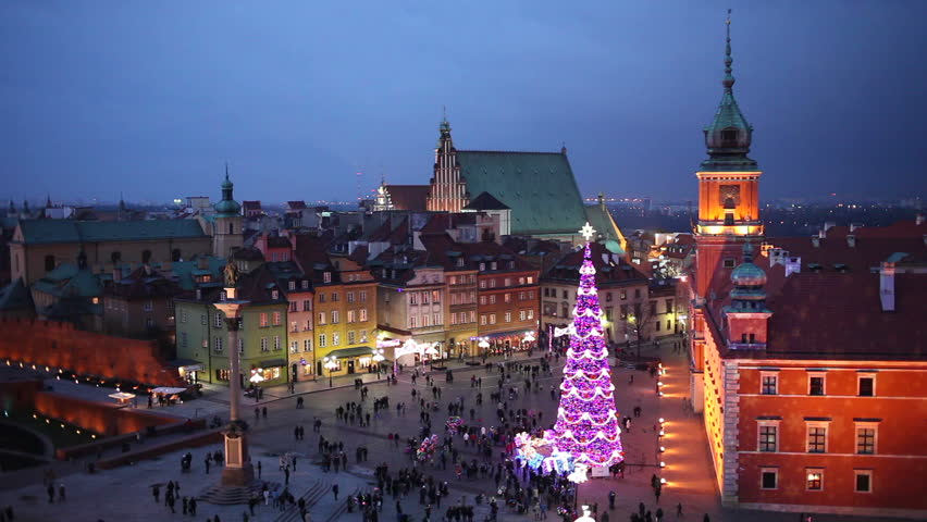 Old Town of Warsaw in Poland illuminated at dusk, during Christmas time.