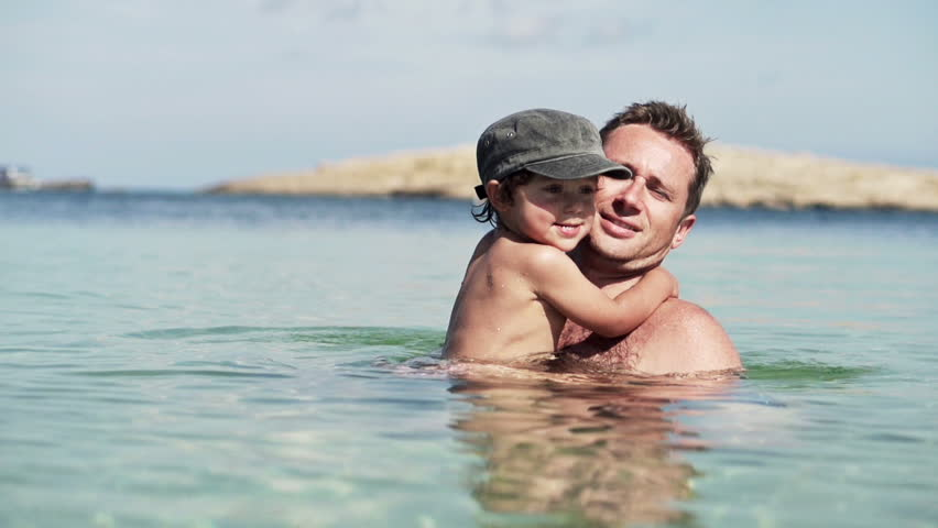 Father and son playing in the sea