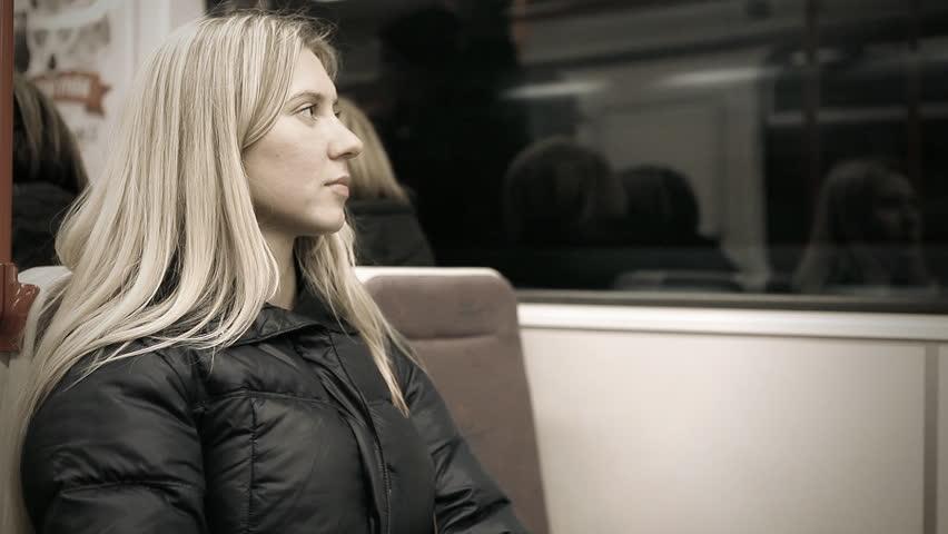 Beautiful young woman seat in empty subway | Shutterstock HD Video #3696935