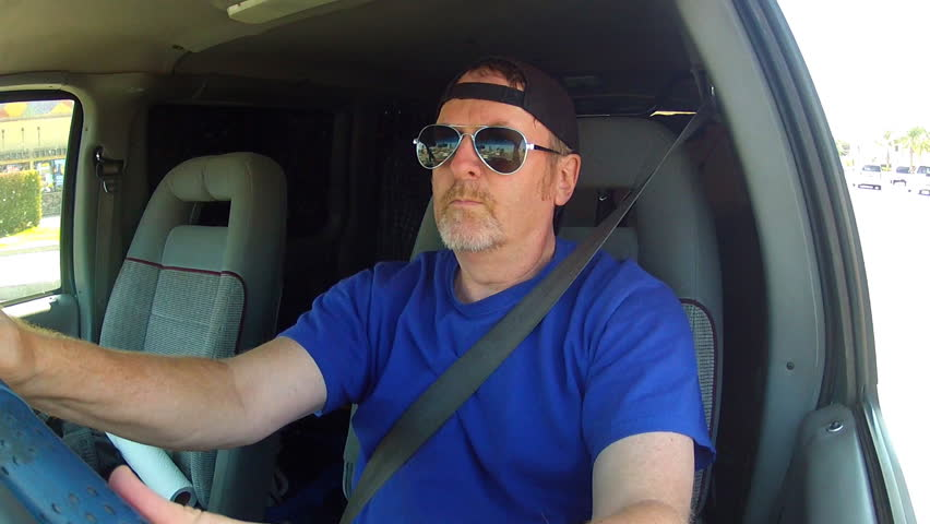 A Medium Shot Of A Middle Aged Man Driving A Delivery Van On The Streets Of  Los Angeles. Stock Footage Video 3699995 | Shutterstock