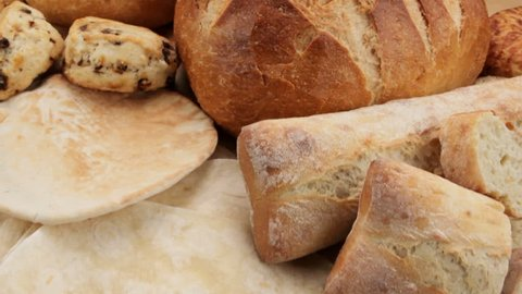 """Baked goods: camera  """"fly over"""" of various breads and baked goods, shot in HD video"""