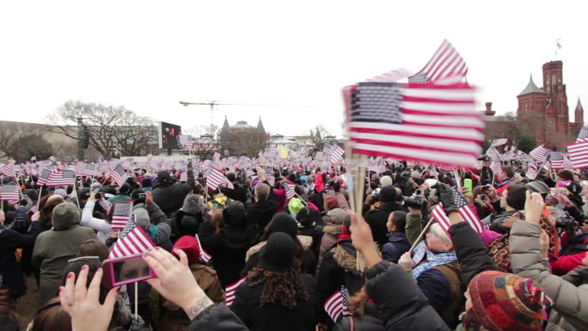 WASHINGTON, D.C. - JANUARY 21: Crowd cheering at inauguration pan shot at Presidential Inauguration January 21, 2013 in Washington, D.C.