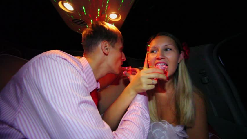 Groom drink brotherhood with bride and then kiss her during ride in limo