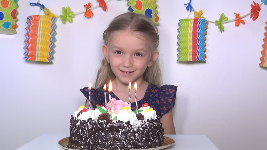 Child Singing Happy Birthday Then Blowing Candles Girl At Her Party Children