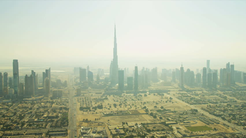 Aerial cityscape view of downtown Dubai heat haze with Burj Khalifa, helicopter blades shadow line, UAE, RED EPIC | Shutterstock HD Video #3726035