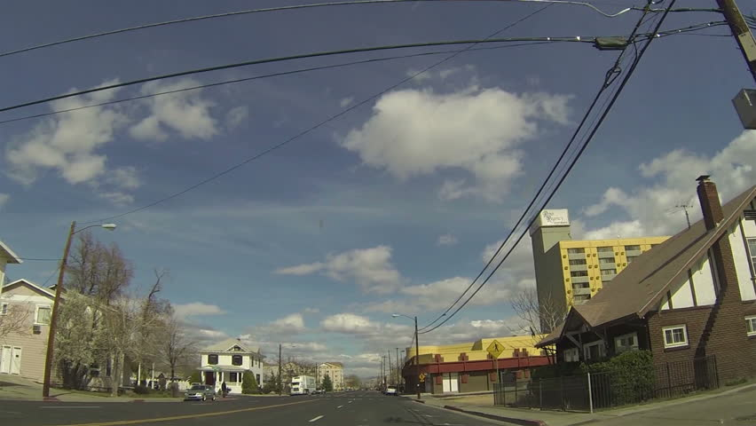 RENO NEVADA MAR 2013: Largest northern gambling center population urban  center. Driving through urban sprawl. Traffic driving. Adult recreation.