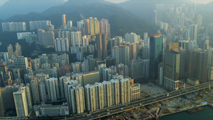 Aerial view Causeway Bay Victoria Harbour and Peak  | Shutterstock HD Video #3741155