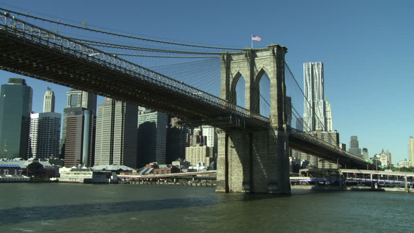 Going under the Brooklyn Bridge and revealing the New York City skyline seen