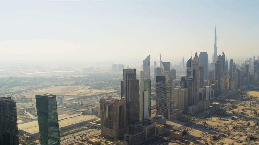 Aerial view of skyscrapers in cosmopolitan downtown Dubai, helicopter blades shadow line, UAE, RED EPIC