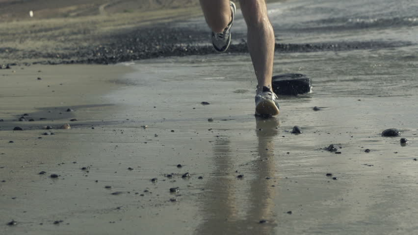 Jogger legs running on the beach, super slow motion, shot at 240fps