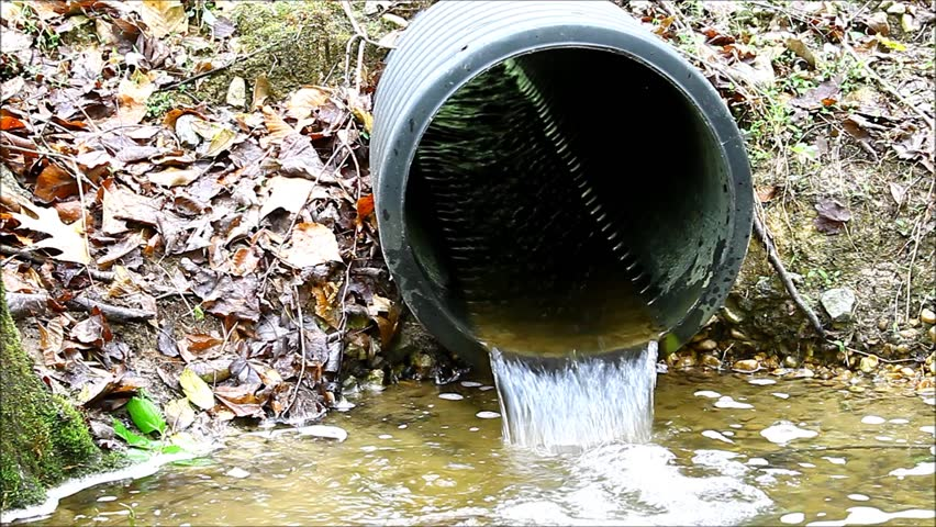 A Black Plastic Storm Drain Pipe With Storm Water Runoff