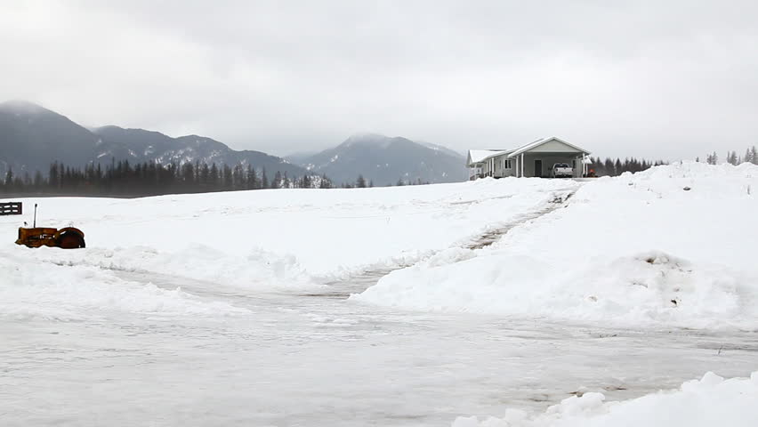 Man slipping on ice on a ranch in Montana | Shutterstock HD Video #3775811