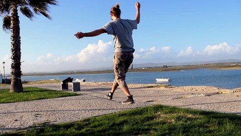 Man balancing and jumping, slackline