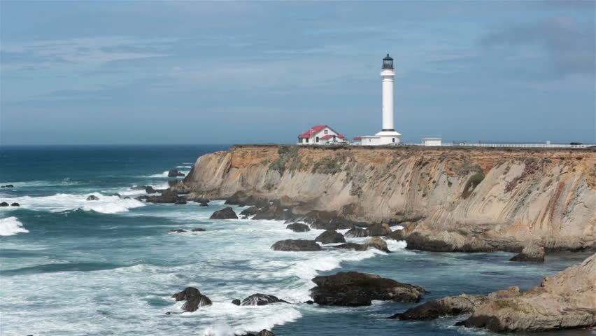 Beautiful California Pacific Ocean coast with historic lighthouse. Rough ocean waves and surf at Point Arena Lighthouse. Coastal California ocean beach, ...