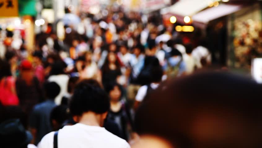TOKYO - CIRCA SEPTEMBER 2012: Anonymous crowds on Takeshita street of Harajuku in Tokyo, Japan.
