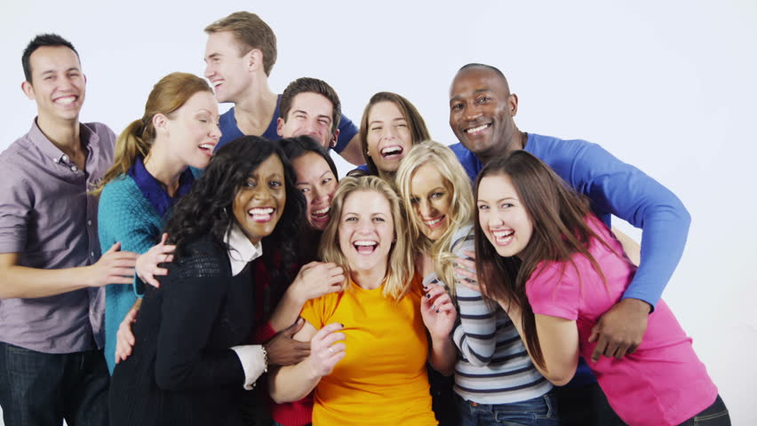 Portrait of a diverse multi ethnic group of people who are standing together, in brightly colored casual clothing and having fun. They are isolated on white in a studio shot. In slow motion. | Shutterstock HD Video #3813755