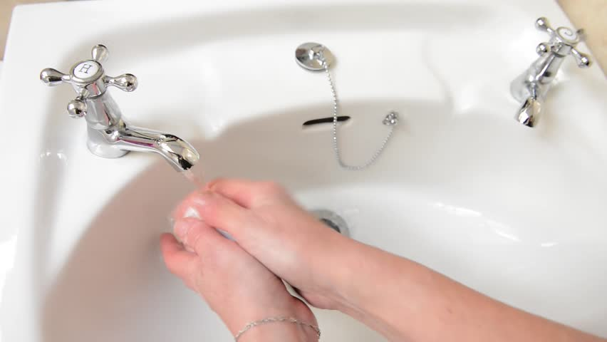 washing hands close up of domestic bathroom sink close up of mature adult woman
